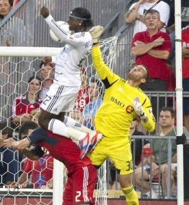 Vancouver Whitecaps FC's Mattocks scores as Toronto FC defender Emory and goalkeeper Kocic defends during second half of their MLS Soccer game in Toronto