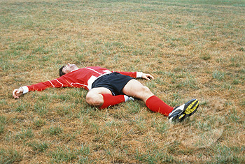 Soccer Player Lying on Field