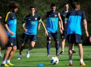 FC Barcelona's David Villa, third right, attends the first training session of the 2012-2013 football season at the Sports Center FC Bacelona Joan Gamper in the San Joan Despi, Spain, Tuesday, July 17, 2012. (AP Photo/Manu Fernandez)